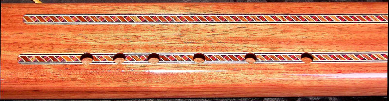 Detail of Rear of Tiger Maple Bubinga Purple Heart Flute by Laughing Crow